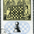 Postage stamp printed in Hungary, devoted to 50th Anniversary of the International Chess Federation, shows Chess Players from 15th Century Manuscript — Stock Photo #55020167
