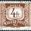 Postage stamp (dues) printed in Hungary, shows a figure - value on the heraldic coat of arms — Stock Photo #55020193