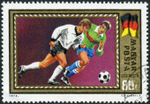 Postage stamp printed in Hungary, dedicated in 1972 UEFA Football Europan Chamionship, Belgium, shows football players and the German flag — Foto Stock