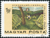 "Postage stamp printed in Hungary, devoted to the 50 Years of Hungarian Communist Party, shows a child's drawing of ""Pioneer Camp"" — Stock Photo"