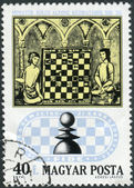 Postage stamp printed in Hungary, devoted to 50th Anniversary of the International Chess Federation, shows Chess Players from 15th Century Manuscript — Foto de Stock