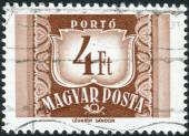 Postage stamp (dues) printed in Hungary, shows a figure - value on the heraldic coat of arms — Stock Photo