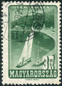 Postage stamp printed in Hungary shows the village of Tihany at Lake Balaton and Tihany Abbey — Stok fotoğraf