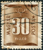 Postage stamp (dues) printed in Hungary, shows a number - value and postal horn — Stock Photo
