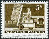 Postage stamp printed in Hungary shows Hydraulic lift truck and mail car — Stock Photo