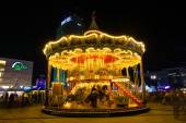 Carousel at Alexanderplatz square in the night illumination. The annual Festival of Lights 2014 — Stock Photo