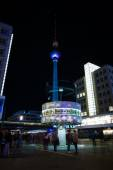 The Weltzeituhr (Worldtime Clock) at Alexanderplatz and Berlin TV Tower in the night illumination. The annual Festival of Lights 2014 — Stock Photo
