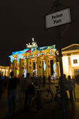 Brandenburg Gate and Pariser Platz in the night illumination. The annual Festival of Lights 2014 — Stock Photo