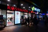 Drugstore Rossmann in night illumination. Rossmann - is Germany's largest retail chain drugstore, 1,900 branches and 28,000 employees. — Stock Photo