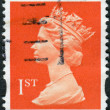 Postage stamp printed in England, shows a portrait of Queen Elizabeth II — Stock Photo #57024823