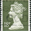 Postage stamp printed in England, shows a portrait of Queen Elizabeth II — Stock Photo #57024865