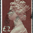 Postage stamp printed in England, shows a portrait of Queen Elizabeth II — Stock Photo #57025413