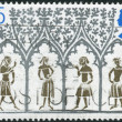 Postage stamp printed in England, is dedicated to 800th Anniversary of Ely Cathedral, shows a 14th Century Peasants from Stained-glass Window — Stock Photo #57026945