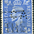 Postage stamp printed in England, shows King of the United Kingdom and the Dominions of the British Commonwealth, George VI — Stock Photo #57027127