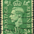 Postage stamp printed in England, shows King of the United Kingdom and the Dominions of the British Commonwealth, George VI — Stock Photo #57027175