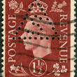 Postage stamp printed in England, shows King of the United Kingdom and the Dominions of the British Commonwealth, George VI — Stock Photo #57027211