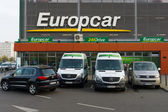 Europcar is a car rental company owned by Eurazeo. Europcar today operates a fleet of over 200,000 vehicles at 2,825 locations in 143 different countries — Stock Photo