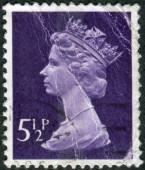 Postage stamp printed in England, shows a portrait of Queen Elizabeth II — Zdjęcie stockowe