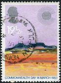Postage stamp printed in England, dedicated to Commonwealth Day, shows Landscapes by Donald Hamilton Fraser, Desert — Fotografia Stock