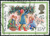 Postage stamp printed in England, Christmas Issue, shows the Holly and the Ivy — Stock Photo