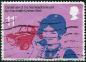 Postage stamp printed in England, dedicated to 1st telephone call by Alexander Graham Bell, shows a District nurse making social welfare call — Foto de Stock