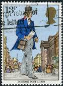 Postage stamp printed in England, dedicated to Death Centenery of Sir Rowland Hill, shows a London Postman, 1839 — Foto Stock