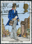 Postage stamp printed in England, dedicated to Death Centenery of Sir Rowland Hill, shows a London Postman, 1839 — Stock Photo