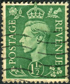 Postage stamp printed in England, shows King of the United Kingdom and the Dominions of the British Commonwealth, George VI — Foto de Stock