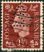 Postage stamp printed in England, shows King of the United Kingdom and the Dominions of the British Commonwealth, George VI — Stock Photo