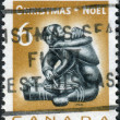 Postage stamp printed in Canada, Christmas Issue, shows Eskimo soapstone carving: Mother and infant, by Munamee of Cape Dorset — Stock Photo #57681953