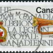 Postage stamp printed in Canada, dedicated to the 50th anniversary of the Royal Canadian Legion, shows Legion Emblem and Bugle — Stock Photo #57682845
