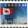 Postage stamp printed in Canada, shows Flag and Canada Post Headquarters, Ottawa — Stock Photo #57683663