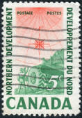 Postage stamp printed in Canada, dedicated to Development of Canada's Northland, shows Compass Rose, Earth Mover and Surveyor — Stock Photo
