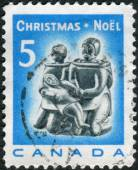 Postage stamp printed in Canada, Christmas Issue, shows Eskimo soapstone carving: Eskimo Family — Stock Photo