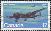 Postage stamp printed in Canada shows a British four-engined Second World War heavy bomber, Avro Lancaster — Stock Photo