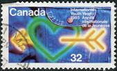Postage stamp printed in Canada, dedicated to International Youth Year, shows the Heart, arrow, jeans — Stockfoto