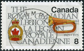 Postage stamp printed in Canada, dedicated to the 50th anniversary of the Royal Canadian Legion, shows Legion Emblem and Bugle — Fotografia Stock
