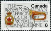 Postage stamp printed in Canada, dedicated to the 50th anniversary of the Royal Canadian Legion, shows Legion Emblem and Bugle — Stock Photo