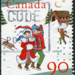 Postage stamp printed in Canada, dedicated to the 50th anniversary of UNICEF, shows children skating — Stock Photo #57761493