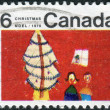 Postage stamp printed in Canada, Christmas issue, shows Children and Christmas Tree — Stock Photo #57762103