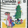 "Postage stamp printed in Canada, Christmas Issue, depicts a children's drawing ""Family under the Christmas tree"" — Stock Photo #57767107"