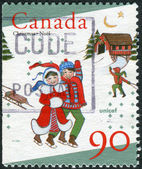 Postage stamp printed in Canada, dedicated to the 50th anniversary of UNICEF, shows children skating — Stock Photo