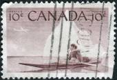 Postage stamp printed in Canada, shows Eskimo and Kayak — Stock Photo