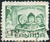 Postage stamps printed in Canada, depicts Singing Children and Peace Tower, Ottawa — Stock Photo