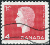 Postage stamp printed in Canada, shows portrait of Queen Elizabeth II and Electric high tension tower — Stock Photo