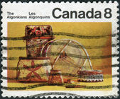 Postage stamp printed in Canada, shows artifacts of the indigenous people of North America - Algonquian — Stock Photo