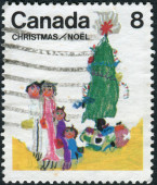 "Postage stamp printed in Canada, Christmas Issue, depicts a children's drawing ""Family under the Christmas tree"" — Stock Photo"
