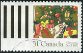 Postage stamp printed in Canada, Christmas Issue, shows the gifts on the Christmas tree — Stock Photo