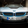 BERLIN - NOVEMBER 28, 2014: Showroom. The BMW i8, first introduced as the BMW Concept Vision Efficient Dynamics, is a plug-in hybrid sports car developed by BMW — Stock Photo #59226961