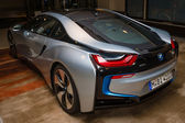 BERLIN - NOVEMBER 28, 2014: Showroom. The BMW i8, first introduced as the BMW Concept Vision Efficient Dynamics, is a plug-in hybrid sports car developed by BMW. Rear view. — Stock Photo